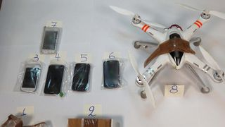 Drone-drops-mobile-phones-over-prison-walls_2.w_l